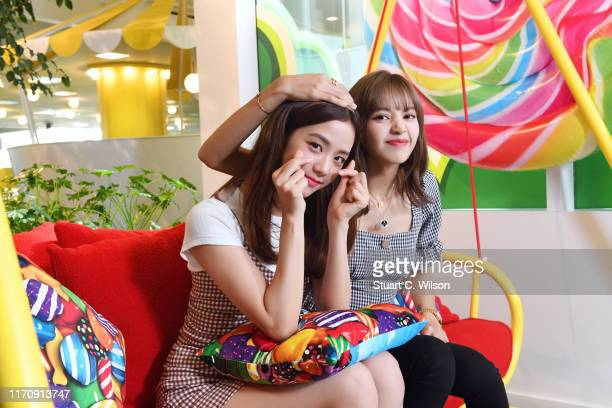 Kim Jisoo and Lalisa Manoban from BLACKPINK try out Candy Crush Friends Sagas new Hungry Yeti AR feature at the King Offices on August 28 2019 in...