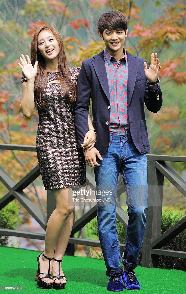 Kim Ji-Won and Min-Ho of SHINee pose for photographs during SBS