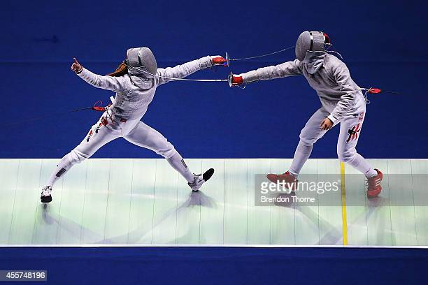 Kim Jiyeon of South Korea and Sin Ying Au of Hong Kong compete in the Women's Sabre Round of 16 during day one of the 2014 Asian Games at Goyang...