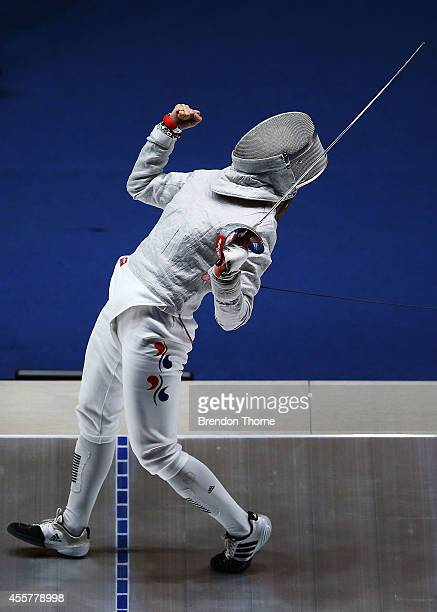 Kim Jiyeon of South Korea celebrates after victory over Shen Chen of China following the Women's Sabre Semi Final during day one of the 2014 Asian...