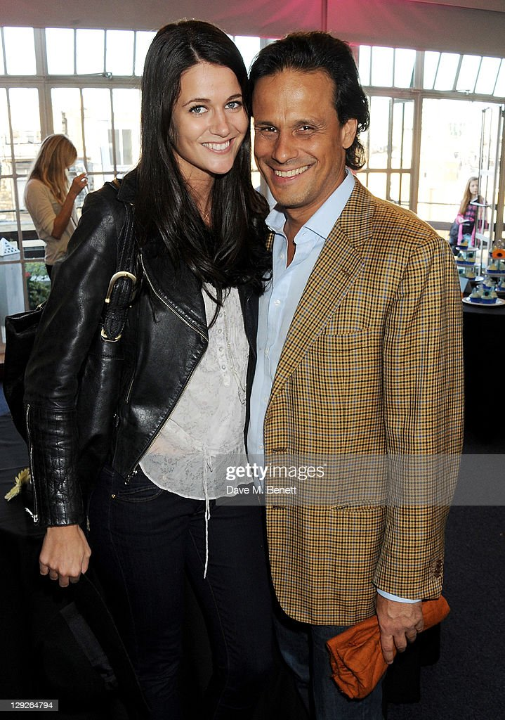 Kim Johnson (L) and Arun Nayar attend the AMNESTEA Party hosted by Patrick Cox to celebrate Amnesty International's 50th Anniversary and launch 'Art Cakes & Cookies' at Royal Institute of British Architects on October 15, 2011 in London, England.