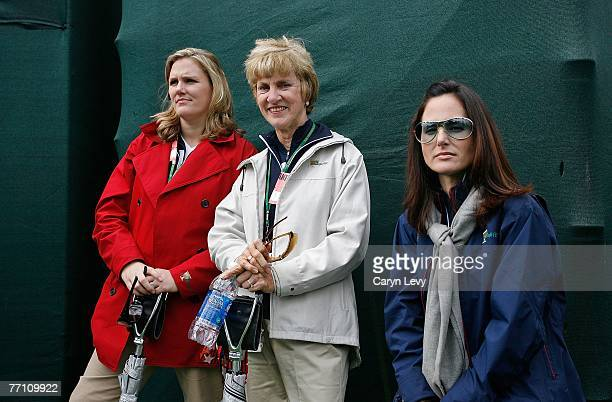 Kim Johnson Barbara Nicklaus and Sonya Toms watch their husbands during round three of day six of The Presidents Cup at The Royal Montreal Golf Club...