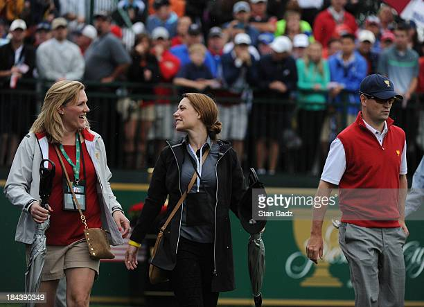 Kim Johnson Nieke Coetzee and Zach Johnson of the US Team on the first hole during the Final Round Singles Matches of The Presidents Cup at the...