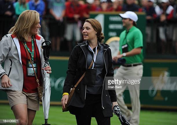 Kim Johnson wife of Zach Johnson of the US Team speak with Nieke Coetzee girlfriend of Branden Grace of the International Team on the first hole...