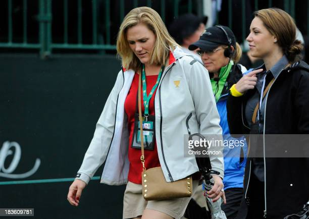 Kim Johnson wife of Zach Johnson of the US Team speak with Nieke Coetzee the girlfriend of Branden Grace of the International Team during the Final...