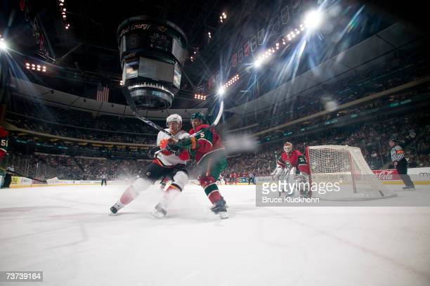 Kim Johnsson of the Minnesota Wild skates against Alex Tanguay of the Calgary Flames during the game at Xcel Energy Center on March 27, 2007 in Saint...