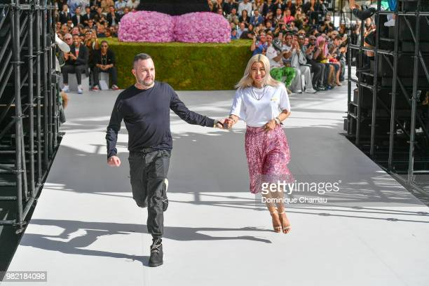 Kim Jones and guest walk the runway during the Dior Homme Menswear Spring/Summer 2019 show as part of Paris Fashion Week on June 23 2018 in Paris...