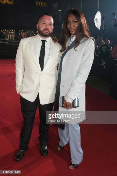 Kim Jones and Naomi Campbell attend the the GQ Men Of The Year Awards 2019 in association with HUGO BOSS at the Tate Modern on September 3 2019 in...