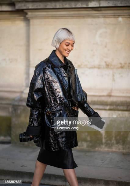 Kim Jones is seen wearing black vinyl coat outside Louis Vuitton during Paris Fashion Week Womenswear Fall/Winter 2019/2020 on March 05 2019 in Paris...