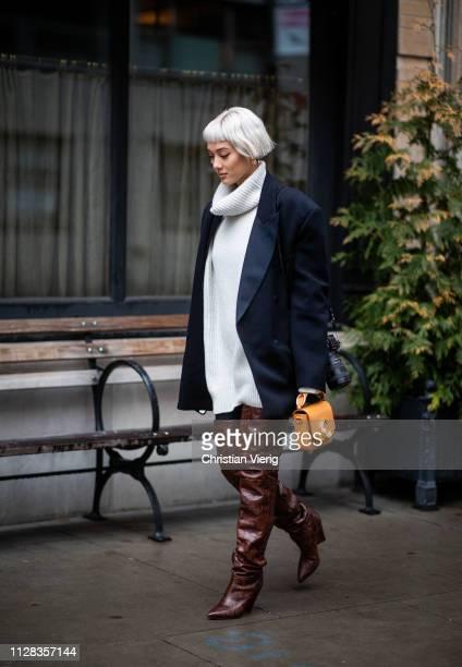 Kim Jones is seen wearing turtleneck oversized blazer brown overknees boots outside Nanushka during New York Fashion Week Autumn Winter 2019 on...