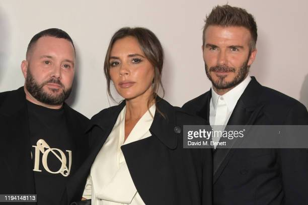 Kim Jones, Victoria Beckham and David Beckham attend the Dior Homme Menswear Fall/Winter 2020-2021 show as part of Paris Fashion Week on January 17,...