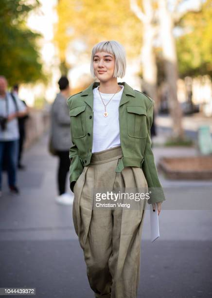 Kim Jones wearing olive cropped jacket olive pants is seen outside Sacai during Paris Fashion Week Womenswear Spring/Summer 2019 on October 1 2018 in...