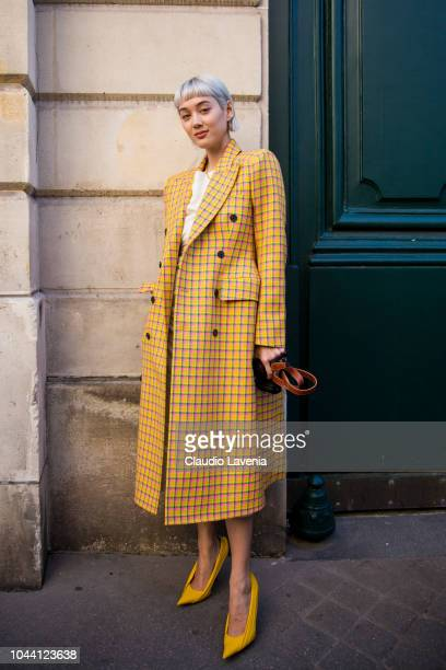 Kim Jones wearing yellow checked coat is seen after the Jacquemus show on September 24 2018 in Paris France