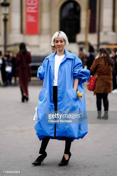 Kim Jones wears a blue oversized coat outside Chanel during Paris Fashion Week Womenswear Fall/Winter 2019/2020 on March 05 2019 in Paris France