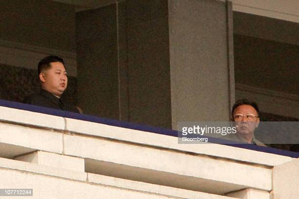 Kim Jong Il, leader of North Korea looks towards his son Kim Jong Un, during a military parade commemorating the 65th anniversary of founding of the...