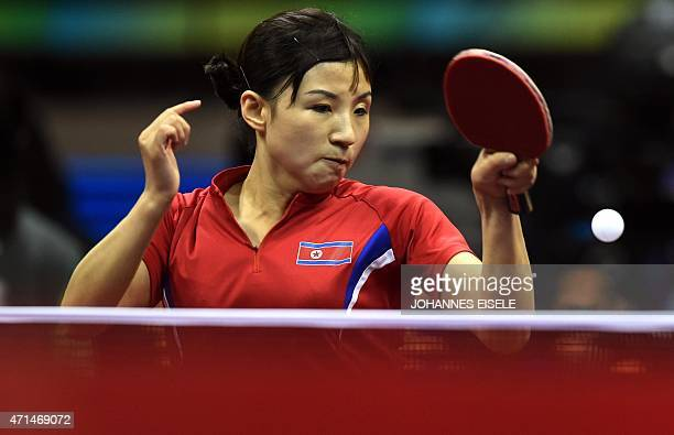 Kim Jong of North Korea hits a return during her women's singles match against Hirano Miu of Japan at the 2015 World Table Tennis Championships in...