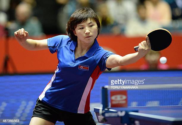Kim Jong of North Korea returns a shot against Ding Ning of China during their women's singles round four match at the 2014 World Team Table Tennis...