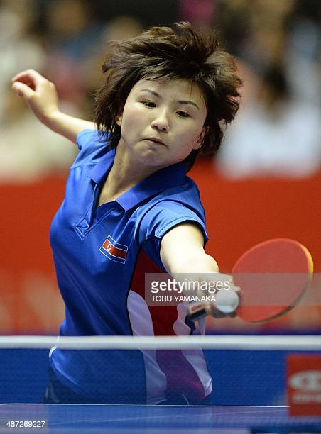 Kim Jong of North Korea returns a shot against Elizabeta Samara of Romania during their women's singles round two match of the 2014 World Team Table...