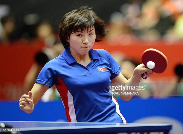 Kim Jong of North Korea returns a shot against Zhu Yuling of China during their women's team quarterfinal match of the 2014 World Team Table Tennis...