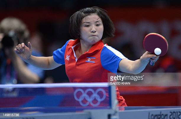Kim Jong of North Korea returns a shot to Feng Tianwei of Singapore during a table tennis women's team match of the London 2012 Olympic Games at the...