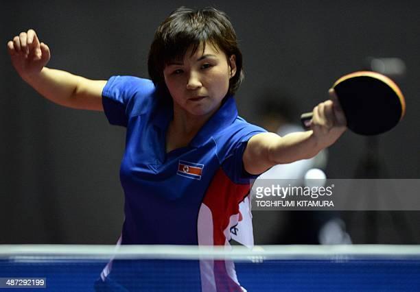 Kim Jong of North Korea returns the ball towards Natalia Partyka of Poland during their women's singles round three match of the 2014 World Team...