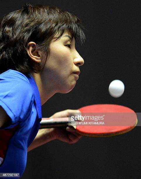 Kim Jong of North Korea serves the ball towards Natalia Partyka of Poland during their women's singles round three match of the 2014 World Team Table...