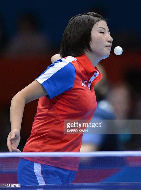 Kim Jong of North Korea serves to Feng Tianwei of Singapore during a table tennis women's team match of the London 2012 Olympic Games at the Excel...