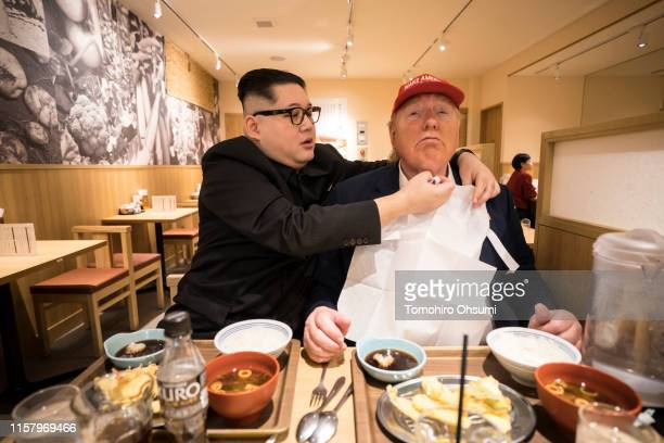 Kim Jong Un impersonator Howard X and Donald Trump impersonator Dennis Alan sit in a restaurant on June 24 2019 in Osaka Japan Leaders from the Group...