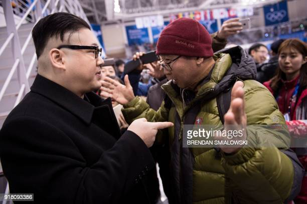Kim Jong Un impersonator is confronted during the final period of the women's preliminary round ice hockey match between Unified Korea and Japan...