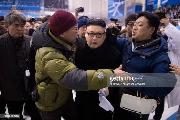 Kim Jong Un impersonator is forced out in the final period of the women's preliminary round ice hockey match between Japan and the Unified Korean...