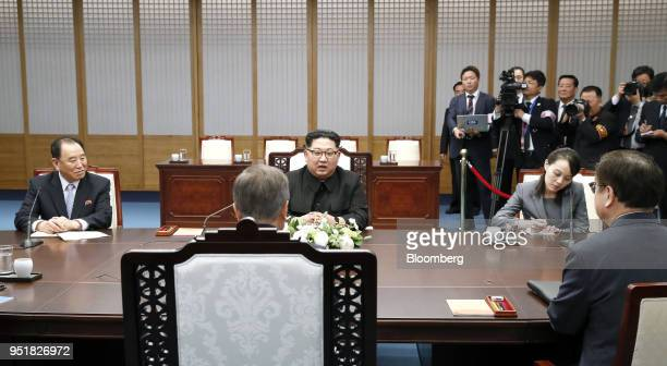 Kim Jong Un North Korea's leader center and Kim's sister Kim Yo Jong second right sit across from Moon Jaein South Korea's president front left...