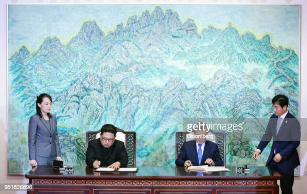Kim Jong Un North Korea's leader center left and Moon Jaein South Korea's president center right sign the deal to end a sevendecade war as Kim's...