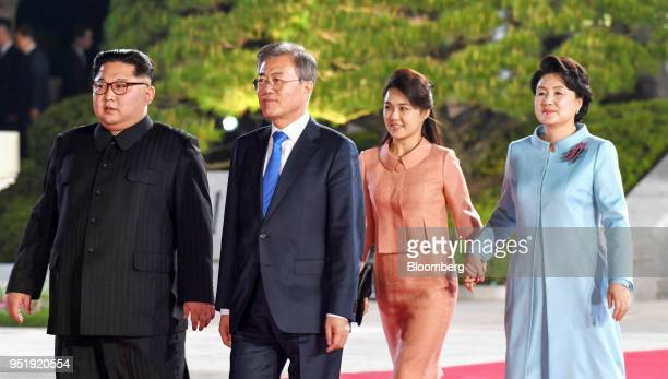 Kim Jong Un North Korea's leader left and Moon Jaein South Korea's president second left Kim Jungsook South Korea's first lady right and Ri Sol Ju...