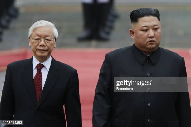 Kim Jong Un, North Korea's leader, right, and Nguyen Phu Trong, Vietnam's President, attend a welcoming ceremony at the Presidential Palace in Hanoi,...