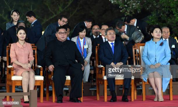 Kim Jong Un North Korea's leader second left and Moon Jaein South Korea's president second right Kim Jungsook South Korea's first lady right and Ri...