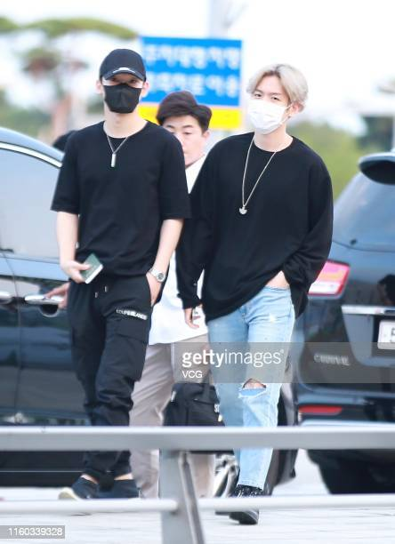 Kim Jongdae and Byun Baekhyun of South KoreanChinese boy group are seen at Incheon International Airport on July 5 2019 in Incheon South Korea