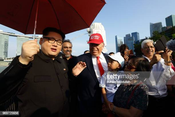 Kim Jongun impersonator Howard X and Donald Trump impersonator Dennis Alan make an appearance at Merlion Park on June 8 2018 in Singapore The White...
