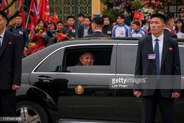 Kim Jongun waves from his car after arriving by train at Dong Dang railway station near the border with China on February 26 2019 in Lang Son Vietnam...
