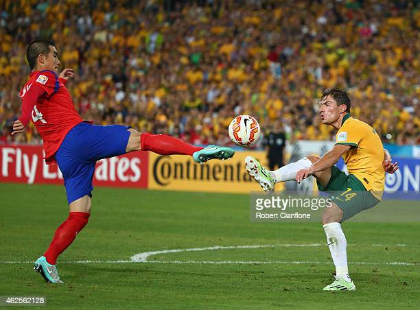 Kim Ju Young of Korea Republic challenges James Troisi of Australia during the 2015 Asian Cup final match between Korea Republic and the Australian...