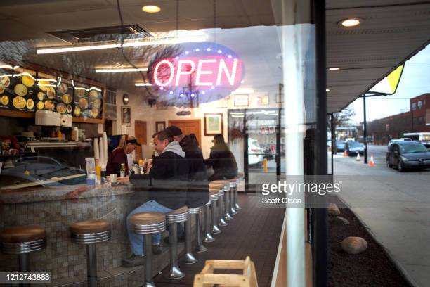 Kim Jugensen waits on customers at Don's Grill in the Pilsen neighborhood on March 16 2020 in Chicago Illinois Yesterday the governors of Illinois...