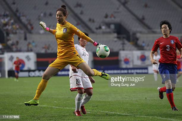Kim JungMi of South Korea competes for the ball with Ra UmSim of South Korea during the EAFF Women's East Asian Cup match between South Korea and...