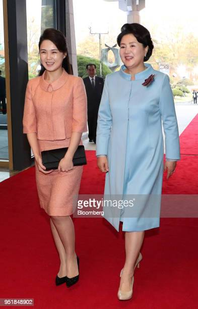 Kim Jungsook South Korea's first lady right and Ri Sol Ju North Korea's first lady arrive for a banquet during the interKorean summit at the Peace...