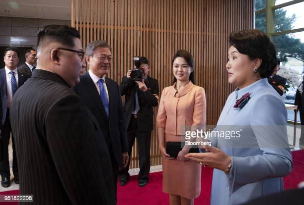 Kim Jungsook South Korea's first lady right speaks with Kim Jong Un North Korea's leader left as Moon Jaein South Korea's president second left and...