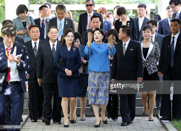 Kim Jungsook wife of South Korean President Moon Jaein talks with Ri Sol Ju wife of North Korean leader Kim Jong Un during a visit to the Kim Wongyun...