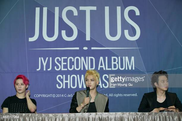 Kim JunSu Kim JaeJoong and Park YooChun of South Korean boy band JYJ attend the 2014 JYJ 2nd Album 'Just Us' show case at COEX Hall on August 3 2014...