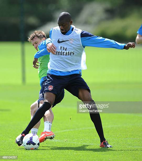 Kim Kallstrom and Abou Diaby of Arsenal during a training session at London Colney on May 10 2014 in St Albans England