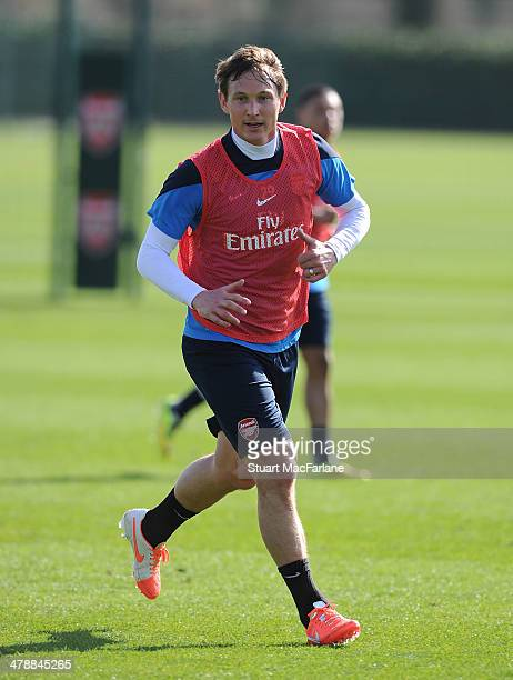 Kim Kallstrom of Arsenal in action during a training session at London Colney on March 15, 2014 in St Albans, England.