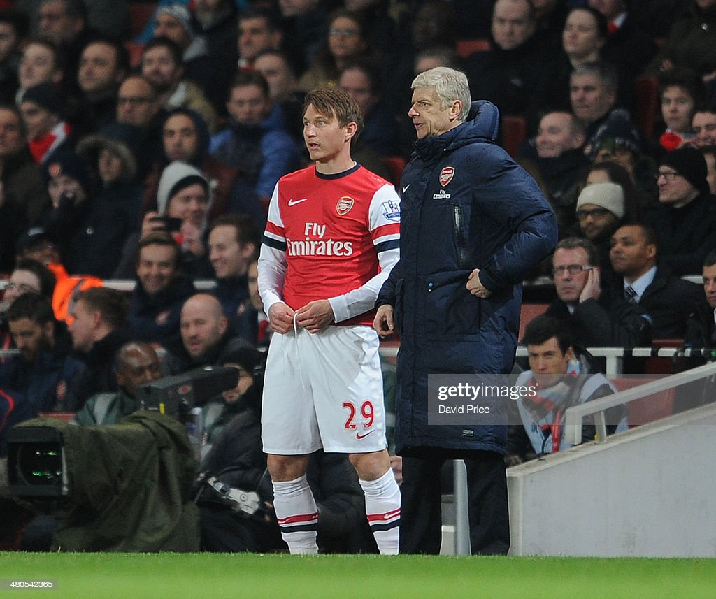 Kim Kallstrom of Arsenal with Arsene Wenger the Arsenal Manager during the match between Arsenal and Swansea City in the Barclays Premier League at...