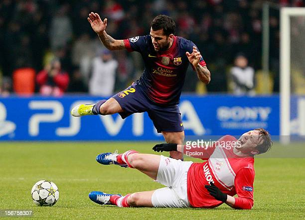 Kim Kallstrom of FC Spartak Moscow battles for the ball with Dani Alves of FC Barcelona during the UEFA Champions League group G match between FC...