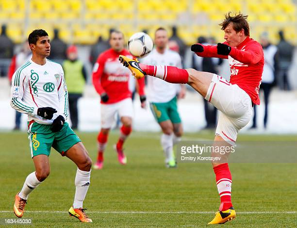Kim Kallstrom of FC Spartak Moscow is challenged by Ailton of FC Terek Grozny during the Russian Premier League match between FC Spartak Moscow and...